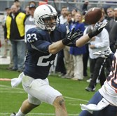 Penn State's Ryan Keiser (23) intercepts an Illinois pass at the goal line in overtime of Penn State's 24-17 win in a game in State College, Pa., Nov. 2, 2013. At right are Illinois' Spencer Harris (80) and Penn State's Adrian Amos.