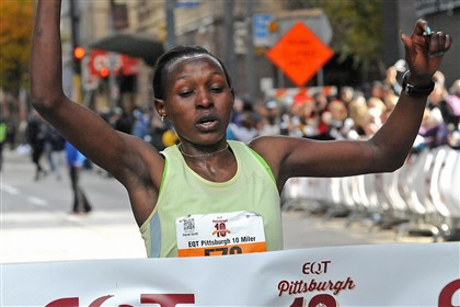 EQT Pittsburgh 10 Miler race winners Sarah Kiptoo crosses the finish line on Liberty Ave., Downtown. She was the women's race winner for the inaugural EQT Pittsburgh 10 Miler. Elijah Maturi Karanja was the men's race winner.