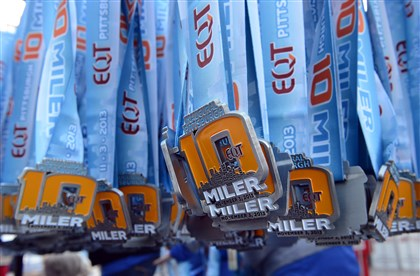 EQT Pittsburgh 10 Miler medals Medals for race participants hang on racks ready to be awarded.