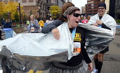 Rebecca Adams, EQT Pittsburgh 10 Miler racer Rebecca Adams of White Oak is wrapped in a heat sheet after she finishes the EQT Pittsburgh 10 Miler.