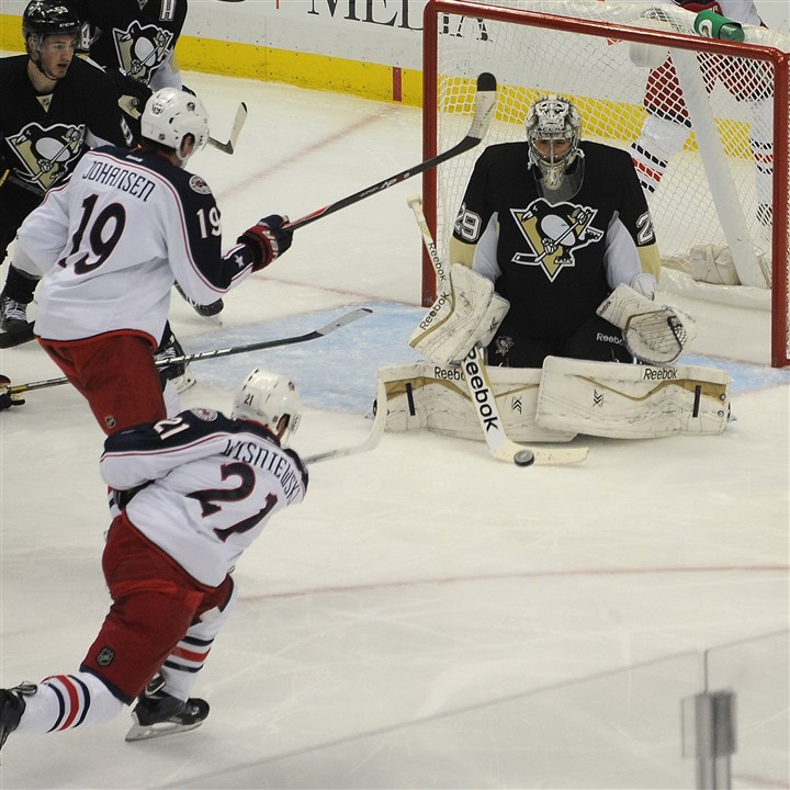 fleury1104c Penguins goalie Marc-Andre Fleury blocks a shot by Columbus' James Wisniewski (#21) Saturday night.