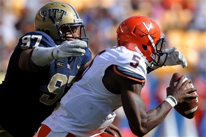 donald1105-3 Pitt's Aaron Donald sacks Virginia's quarterback David Watford during their game against Virginia at Heinz Field in September.