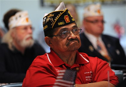 20131104JHLocalVets01 Navy vet Jeff Pope, Post 980, Plum, listens at an American Legion town hall meeting on Monday in Squirrel Hill.