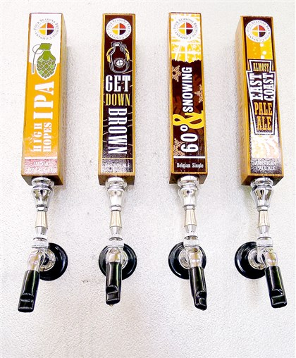 brewer2FOOD-2 The tap handles at the new Four Seasons Brewing Co. near Latrobe. These first four beers will be available for sampling and purchase by the growler at the grand opening on Nov. 9.