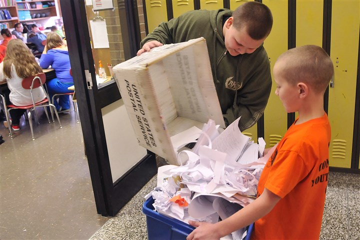 041113lrrecylenorth01-3 At Colfax Upper Elementary School in Springdale, Caleb Feltner, 11, left, and Bryson Andrews, 10, both fifth-graders, collect paper goods from classrooms Monday as part of a recycling competition,