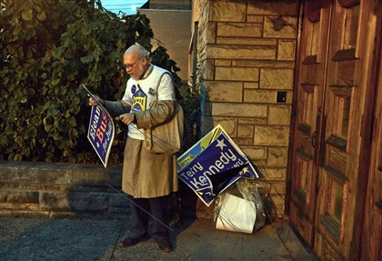 First Signs of an Elections Bill Wekselman of Squirrel Hill arrives around sunrise and before the polls open at Shaare Torah synagogue along Murray Avenue. He was setting up campaign signs.
