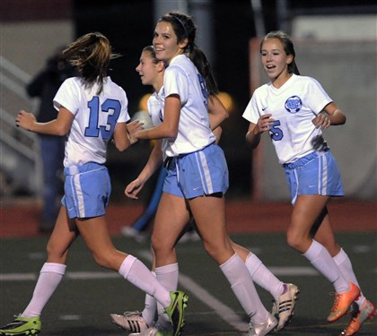 hshigh2 Central Valley's Katie Alexander, center, is all smiles after scoring the go ahead goal in the win against Somerset, 3-2, in the first round of the PIAA playoffs at Moon.