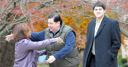 20131105radPedutoVotesLocal03-4 Bill Peduto, Democratic candidate for mayor of Pittsburgh, greets his communications director Sonya Toler as he arrives with advance director Lex Janes to vote at the St. Bede School in Squirrel Hill.