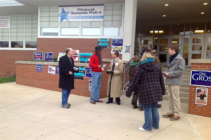 Stanton Heights polling place In Stanton Heights, supporters of competing City Council candidates Tony Ceoffe and Deb Gross greet voters.