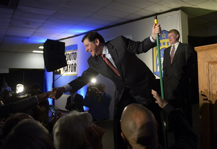 20131105jrPedutoLocal1 Broom in hand, Bill Peduto greets the crowd at his victory party Tuesday night at the Greater Pittsburgh Coliseum in Homewood.