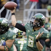 Oregon quarterback Marcus Mariota passes during the first half of an NCAA college football game against UCLA in Eugene, Ore. this fall.
