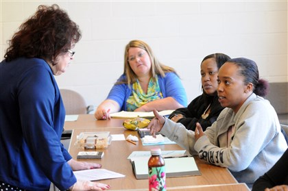 20131107pawomenworkshopbiz Shauna Staten, right, of Homewood asks instructor Gail Wallis Hague how to prepare a resume during a workshop organized by PA Women Work at YWCA in Homewood. At center is Roberta Jones of Penn Hills, and second from right is Jasmin Jennings of Garfield. PA Women Work is a nonprofit that helps women get into the workforce.