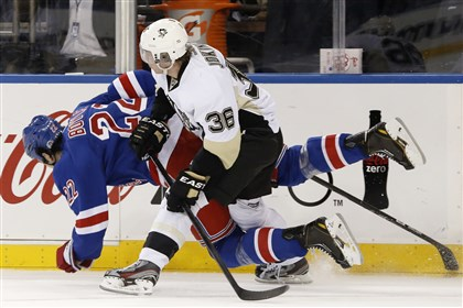 pens1107d-1 New York Rangers center Brian Boyle and Penguins left wing Jussi Jokinen get tangled up in the first period of a game last week at Madison Square Garden in New York.