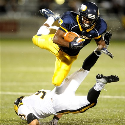 ARush_HSFootball004.jpg Central Catholic's Darnell Clemm, diving over North Allegheny's Nick Woytowitz, is just one of many Vikings offensive threats.