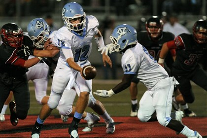 Central Valley Football Central Valley quarterback Nate Climo hands off to JaQuan Pennington during a game against West Allegheny.