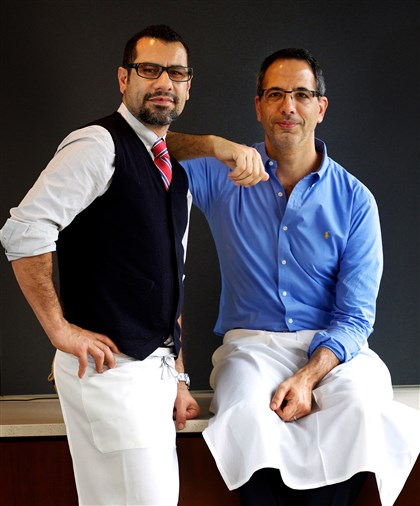 CHEFS41 Chefs Sami Tamimi, left, and Yotam Ottolenghi are unlikely allies and co-authors who helm two popular restaurants in London.