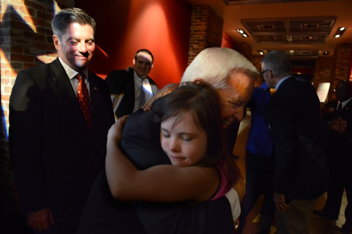 20131106dsCorbettLocal04-1 Gov. Tom Corbett embraces Chloe Kondrich, 10, of Upper St. Clair after announcing his candidacy for re-election Wednesday at the Heinz History Center in the Strip District. To the left is Lt. Gov. Jim Cawley.