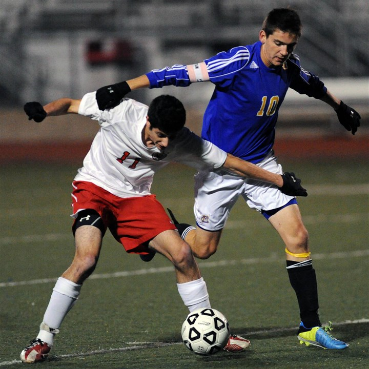 20131028JHSportsSoccer06.jpg Peters Township's Mario Mastrangelo, left, battling Canon-McMillan's Corey McCurdy, scored the only goal in the WPIAL championship match.