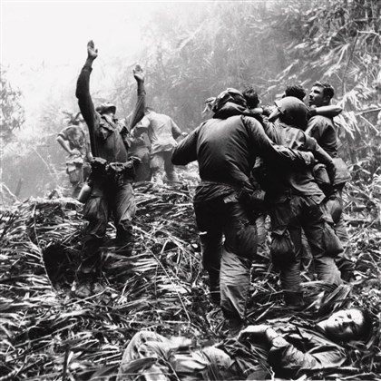 five-day patrol of Hue, South Vietnam Soldiers aid wounded buddies through jungle foliage to be evacuated by a medical evacuation helicopter during a five-day patrol of Hue, South Vietnam, in April, 1968.