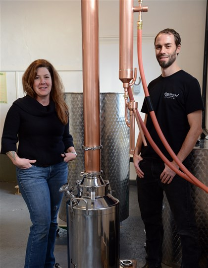 20131108bwDistillMag01 Lee Ann Sommerfeld and Peter Streibig, owners of Stay Tuned Distillery in Munhall, with their still for making gin.