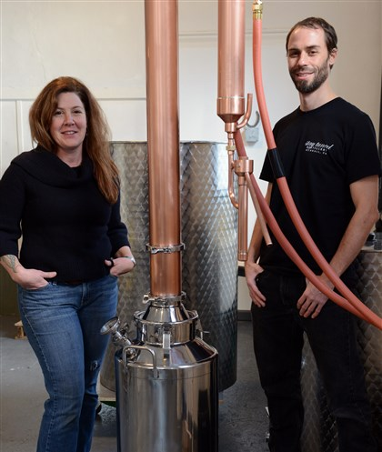 DistillMag01 Lee Ann Sommerfeld and Peter Streibig, owners of Stay Tuned Distillery in Munhall, with their still for making gin.