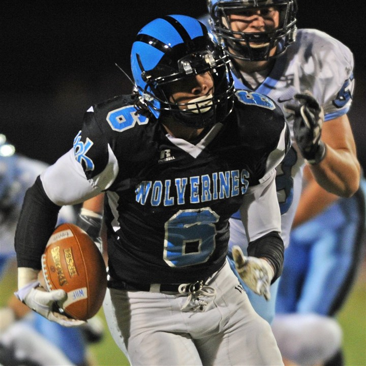 Woodland Hills quarterback Harry Randall Woodland Hills quarterback Harry Randall runs for the Wolverines' first touchdown against Seneca Valley during the WPIAL Class AAAA quarterfinal game Friday night at North Allegheny's Newman Stadium.