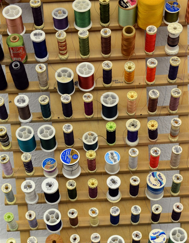 CustomClothMag04-2 Spools of thread at Moda Donnatella custom clothing.