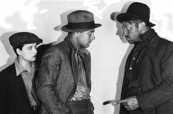 "beggars Actress Louise Brooks (left), and actors Richard Arlen (center) and Wallace Beery in a scene from the 1928 film ""Beggars of Life."""