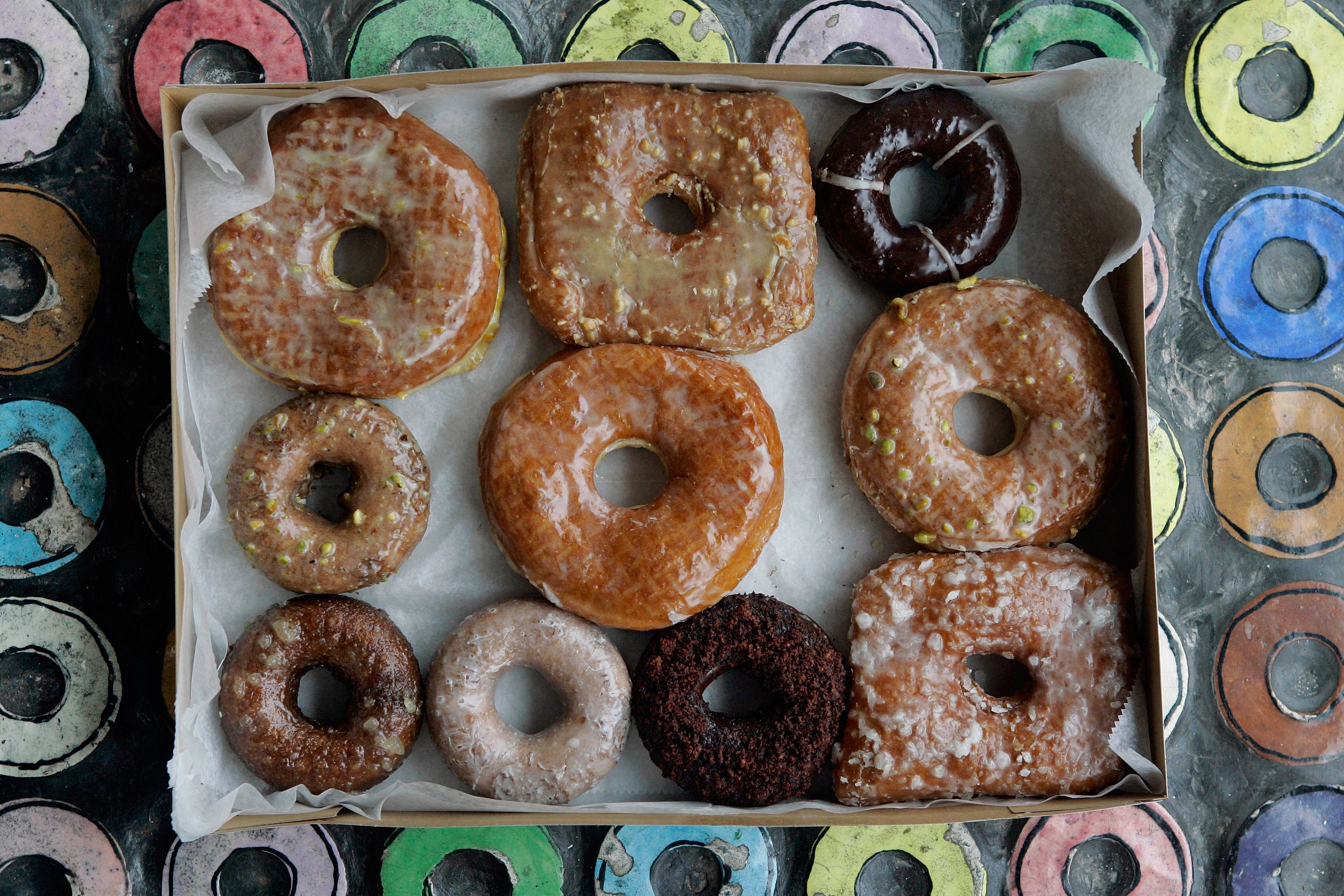 TransFatsDoughnuts-2 In this Jan. 12, 2007 photo, a box with a variety of doughnuts from Doughnut Plant sit in the front window of the shop on New York's Lower East Side. Doughnut Plant owner Mark Isreal has been making trans-fat-free, all-natural doughnuts for a dozen years.