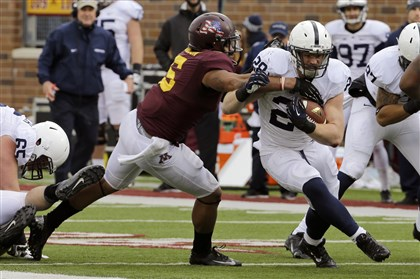 Penn State Minnesota Football Penn State running back Zach Zwinak tries to break the tackle of Minnesota defensive lineman Theiren Cockran as he carries the ball for an 11-yard gain in the second quarter.
