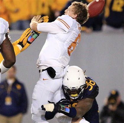 West Virginia's Will Clarke sacks Texas quarterback Case McCoy West Virginia's Will Clarke sacks Texas quarterback Case McCoy Saturday night in Morgantown, W.Va.