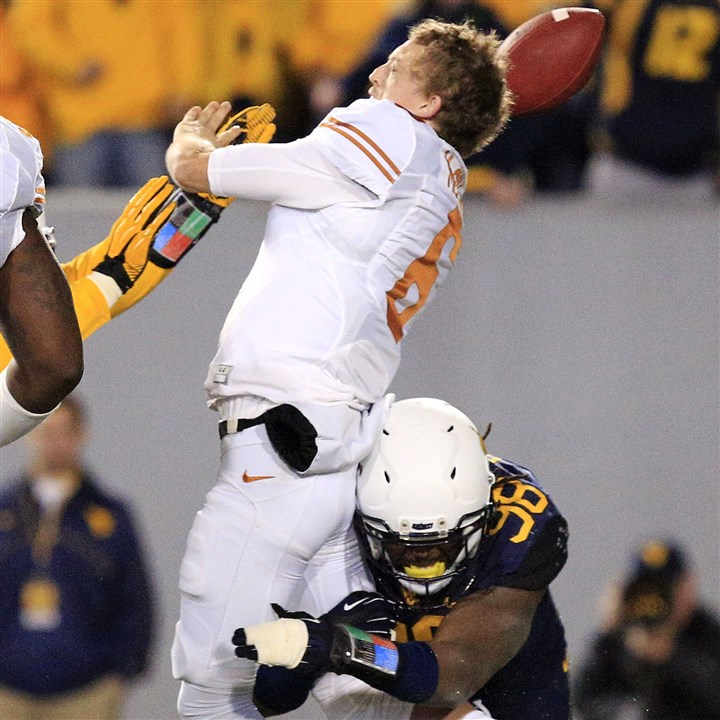 wvu1129 West Virginia defensive lineman Will Clarke sacks Texas quarterback Case McCoy in a game earlier this month.