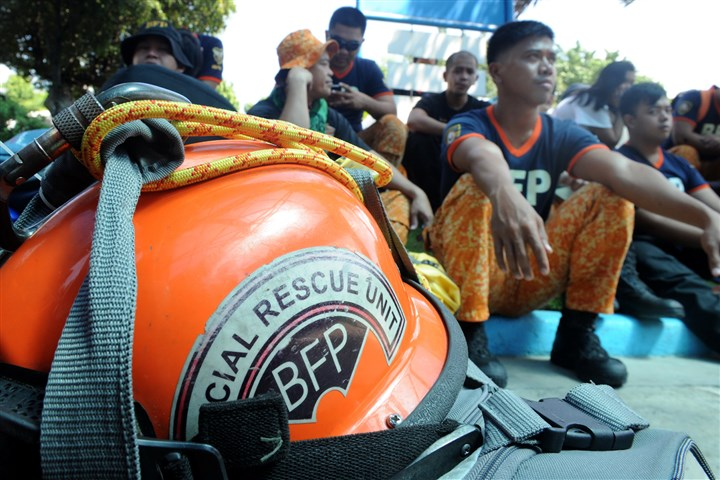 Philippines Typhoon rescue helmet Special fire department rescue personnel and medics prepare to board a C-130 military plane in Manila on Sunday, heading to the typhoon devastated city of Tacloban.