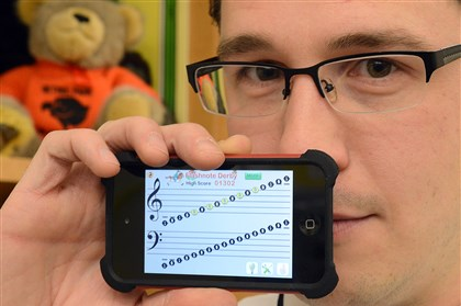 20131111radiPhoneMusicNorth02-1 Edgeworth Elementary music teacher Erik Kolodziej is collecting old iPhones and iPod Touches for his students run music education apps, such as Flashnote Derby, to teach students how to identify notes. Edgeworth Elementary is in the Quaker Valley School District.