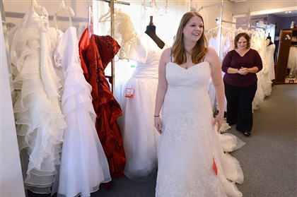 20131111radFreeBrideDressLocal04-3 Abby Miller tries on wedding dresses with Koda Bridal Shop co-owner Karin Mottey. Ms. Miller will marry Army veteran Kevin Cooney on March 21, 2015.
