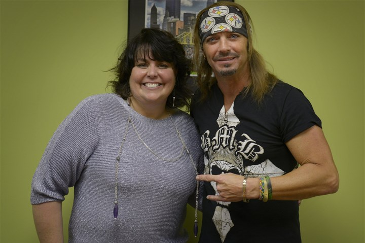 20131110jrBretMichaelsZones1 Mary Beggy-Fischerkeller , a cancer survivor and organizer of Knock Out Cancer, poses with the event's featured celebrity, Bret Michaels, on Sunday at the Galleria in Mt. Lebanon.