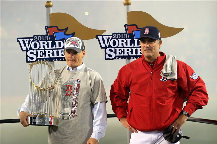 cherington1112 Boston Red Sox manager John Farrell and general manager Ben Cherington, with World Series trophy