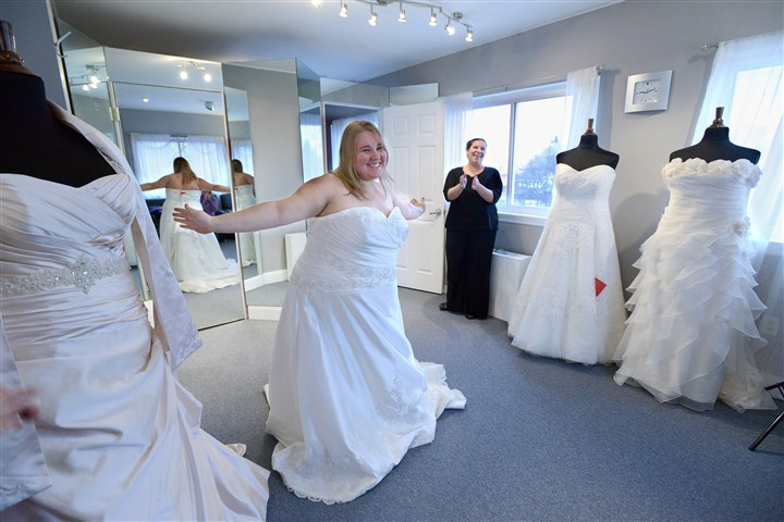 20131111radFreeBrideDressLocal05-4 Bride-to-be Medina Menozzi says yes to the dress with Koda Bridal Shop co-owner Mary Beth Ryfun at the Mt. Lebanon shop Monday morning. Ms. Menozzi will marry Army veteran Alec Chebatoris on April 25, 2015.