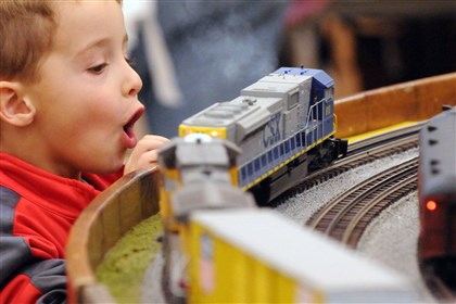 20121111BDtraineast9b600kfb Matthew Wakefield, 4, of Monroeville, is thrilled to see the trains at last year's Greenberg Train and Toy Show at the Monroeville Convention Center.