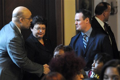 20131112lfBudgetLocal01-1 Councilman Ricky Burgess greets Mayor Luke Ravenstahl on Tuesday at the City-County Building. Council President Darlene Harris is standing beside them.