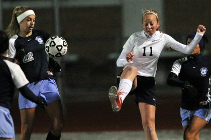 20131112JHSportsSoccer04-1 Hopewell's Abby Losco, right, drives the ball past Central Valley's Ashley Mutkus, left, in a Class AA semifinal.