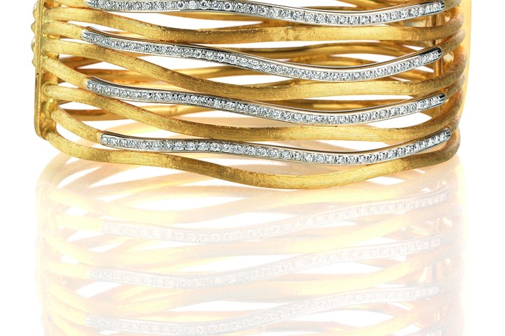 111213_stylebook02.jpg Diamond Jaipur link bracelet hand-engraved with 18-karat yellow gold and diamonds, $23,550.