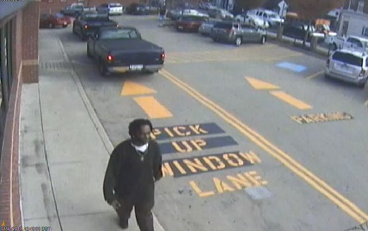 111213_carjack01 A surveillance video captures an image of the carjacking suspect.