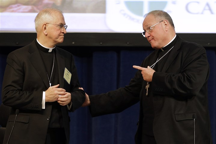 Catholic Bishops Baltimore 2 Cardinal Timothy Dolan, right, of New York speaks with Archbishop Joseph Kurtz, left, of Louisville, Ky., during the conference's annual fall meeting in Baltimore on Tuesday.