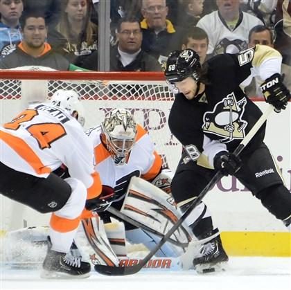20131113pdPenguinsSports04 Kris Letang is stopped by Flyers goalie Ray Emery in the third period at the Consol Energy Center Wednesday night. The Penguins lost 2-1 and are in a 3 game losing streak.