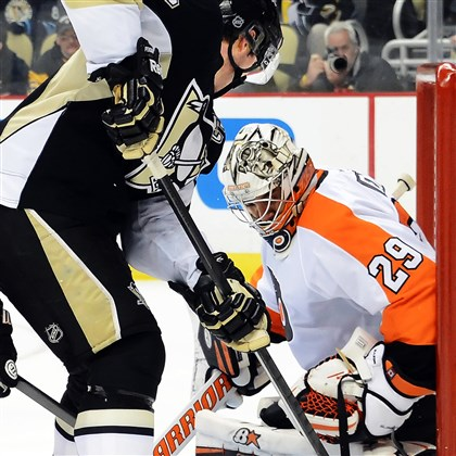 Penguins notebook Sidney Crosby works near the goal against the Flyers' Ray Emery in the third period of the 2-1 loss Wednesday night at Consol Energy Center.