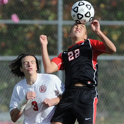 1109mhStClaireVsPetersBoysS.2.jpg Upper St. Clair's Robbie Mertz hits a header against Peters Township's Matthew Massucci during the PIAA quarterfinal match at Chartiers Valley High School stadium on Saturday. Upper St. Clair shut out Peters Township, 3-0.
