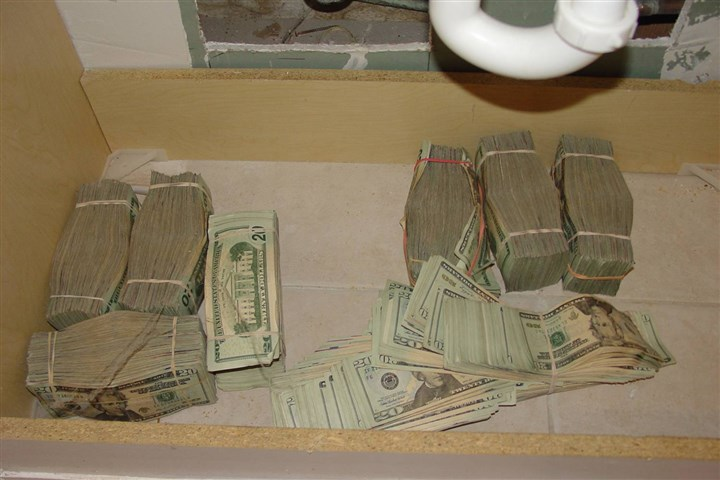 20131113hoKoniasCashSink An FBI agent testified Wednesday that investigators found money under a panel in a vanity inside the home of a taxi driver Kenneth Konias befriended. This photo was submitted as evidence in Mr. Konias' trial.