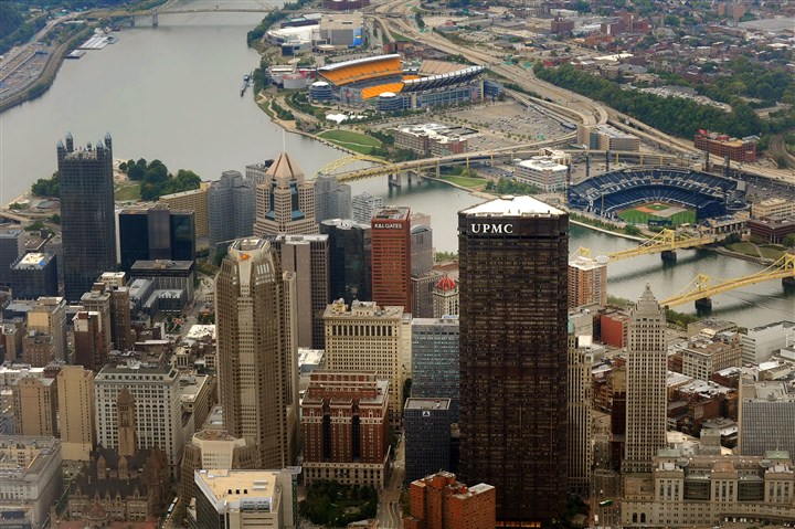 "Aerial view of UPMC and Pittsburgh After a judge dismissed the city's attempt to gain payroll taxes from the healthcare provider, spokesman Paul Wood said, ""We are very pleased with the decision and prepared to defend UPMC's charitable status if there should be any further legal action."""