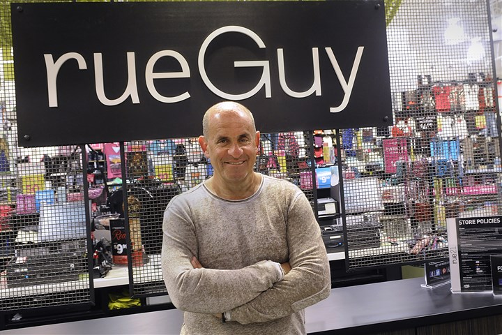 131113lrrueGuybiz03-2 Bob Fisch, CEO of the Cranberry-based Rue 21 chain, poses in the new rueGuy portion of their store on Wednesday at Tanger Outlets in South Strabane.